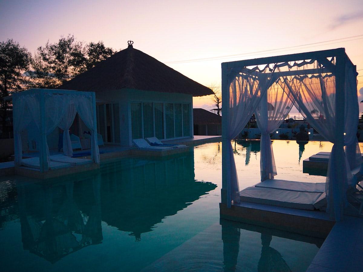 The sunset view by the pool at Villa Gili Bali Beach - Gili Trawangan Bali - The Travel Escape